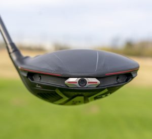Ping G410 Plus Driver- in-hand- back